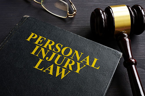 Personal Injury Law book and a black desk